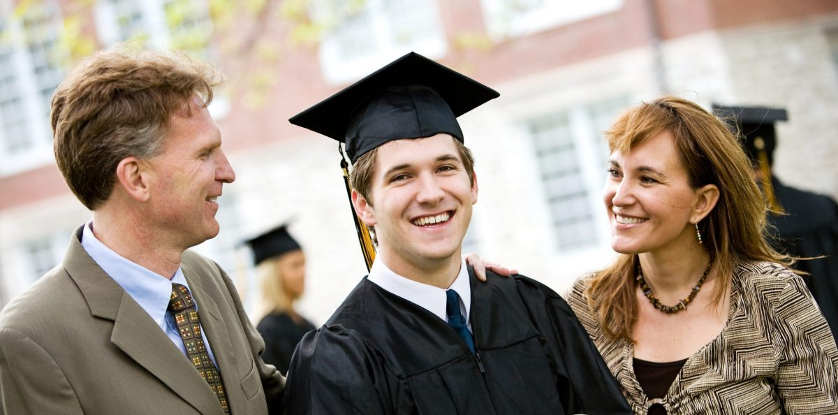 Perdocere Tutoring - Graduate Stands with Parents